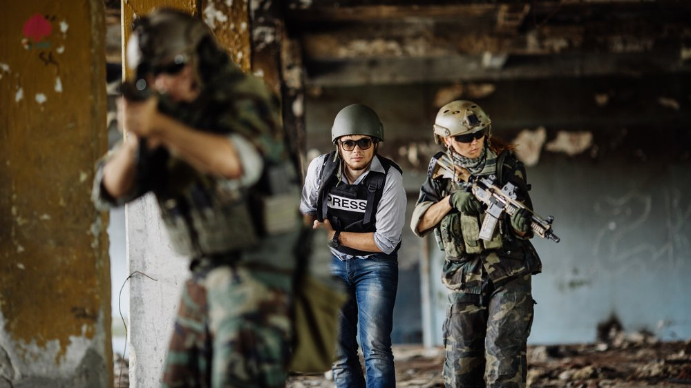 En reportage kan fx skrives fra et krigsområde.