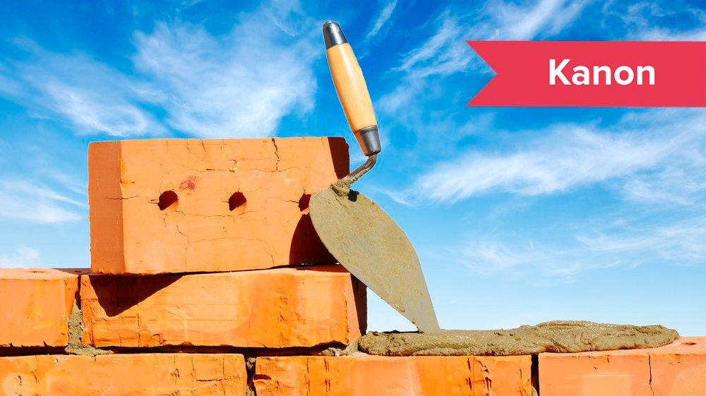 En tekst er bygget op af forskellige dele, ligesom en mur er bygget op af mursten.